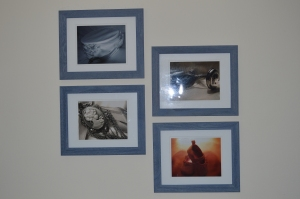 My wall of photography.  I take them, my husband hangs them.  Each picture is supposed to sort of tell a story.  We begin with the past:  my wedding veil, then progress to the cameo (not sure how that fits in), then Hannah's pewter baby rattle and brush, and then the future:  her dancing shoes.